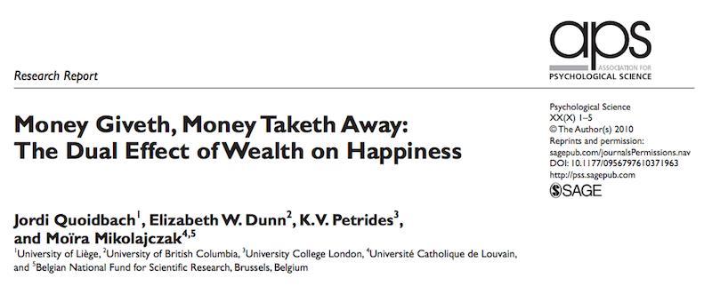The Dual Effect of Wealth on Happiness
